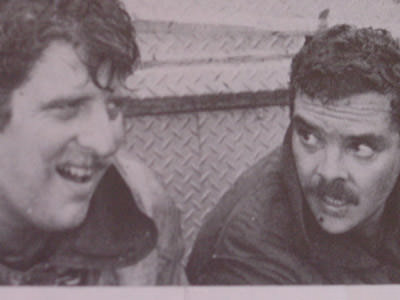 Bob Garrigan on the left rests with Pete Lopez after a harrowing fire